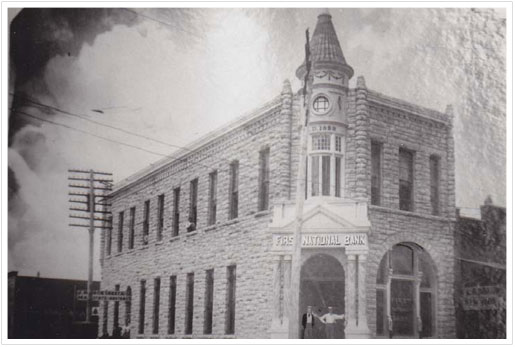 Exterior view of First National Bank building in 1920s or 1930s